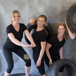 three woman with tyres for strength training weight lifting powerful