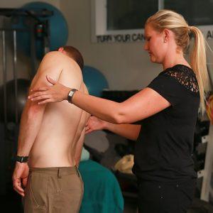 chiropractor muscle testing man