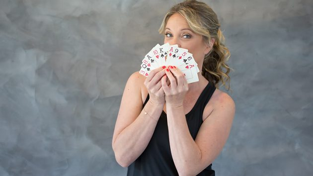 Charlotte May Downey looking strong and fit and holding a deck of cards