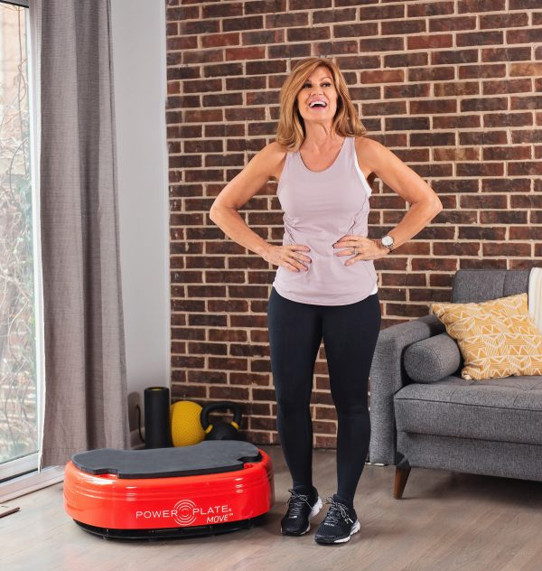 Older menopausal woman with Power Plate Move