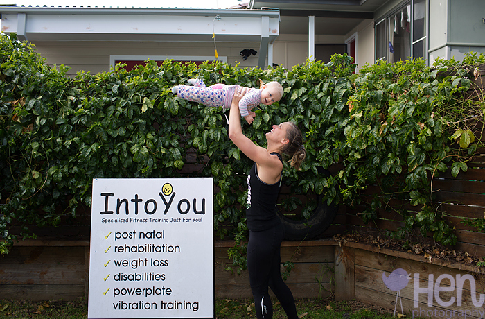Image of mum at IntoYou lifting baby laughing healthy fit strong