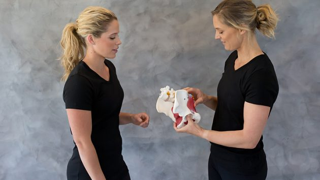 Image of Clare Hozack coaching a personal trainer on pelvic health pelvis pelvic floor deep core