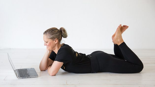 online coach coaching lying down smiling and relaxed