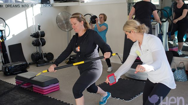 Personal trainer in action at IntoYou with mum mums women woman rip trainer TRX