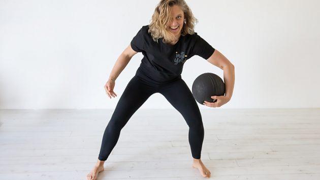 Image of strong woman with sandball