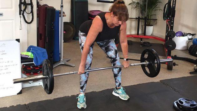 Woman healvy lifting after deep core restore course rehab rehabilitation