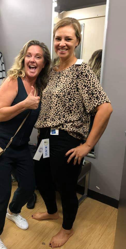 Stylist in changeroom with made-over woman