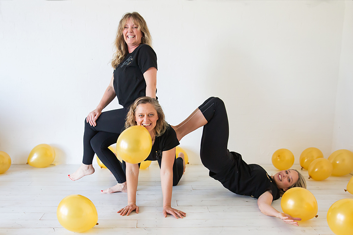 fun photo of personal trainers playing with balloons