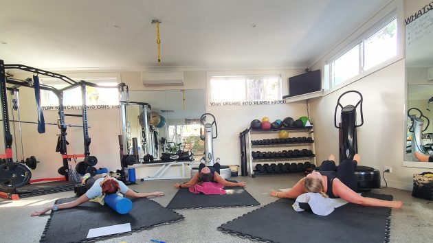 Image of people relaxing on foam roller and Power Plate whole body vibration